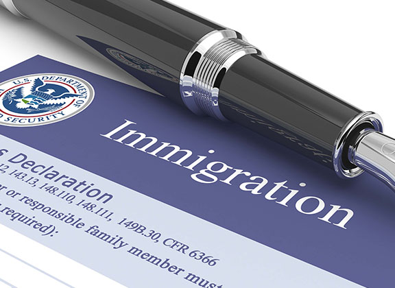 Immigration form with a pen